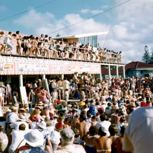 Crowds enjoying entertainment provided at Carnell's Greenmount Beach Kiosk, Coolangatta, Queensland, circa 1960 Photographer unknown