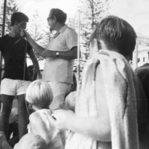 Hypnotist Ron Ricco with his audience on Greenmount Beach, Coolangatta, Queensland, circa 1970 Janice White photographer