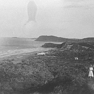 Group of people with a view looking south from North Nobby over Miami to Burleigh Heads, Queensland, circa 1930 Photographer unknown