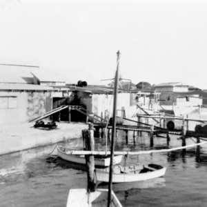 Mineral deposits depot and wharf, Nerang River, Southport, Queensland, circa 1930s Willoughby family, photographer