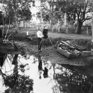 Guy Hunt with camera in natural setting, Southport, circa 1905. Photographer unknown